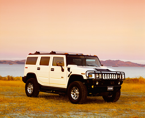 AUT 15 RK0735 01 © Kimball Stock 2003 Hummer H2 White 3/4 Front View On Dry Grass By Water Filtered