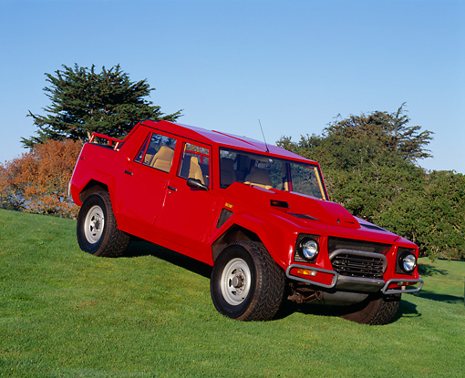 AUT 15 RK0758 06 © Kimball Stock 1988 Lamborghini LM002 Red Front 3/4 View On Grass Hill