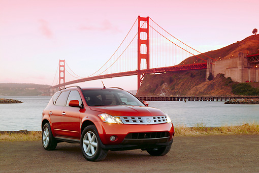 AUT 15 RK0803 01 © Kimball Stock 2004 Nissan Murano Orange Low 3/4 Front View By SF Bridge At Dusk