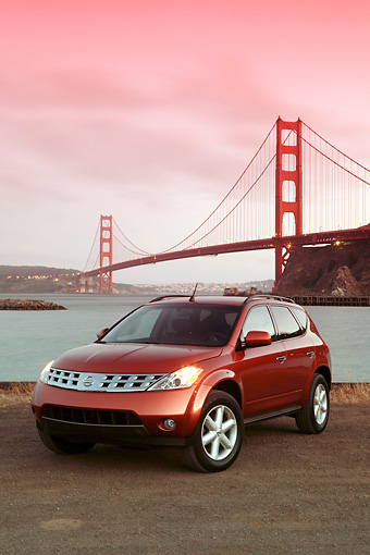 AUT 15 RK0804 01 © Kimball Stock 2004 Nissan Murano Orange 3/4 Front View By SF Bridge At Dusk