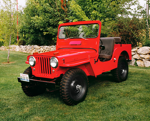 AUT 15 RK0841 02 © Kimball Stock 1952 Willys CJ-3A Red 3/4 Front View On Grass