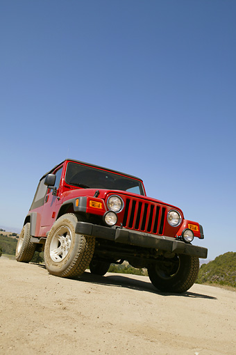 AUT 15 RK0847 01 © Kimball Stock 2004 Jeep Wrangler Red 3/4 Front Low View On Road