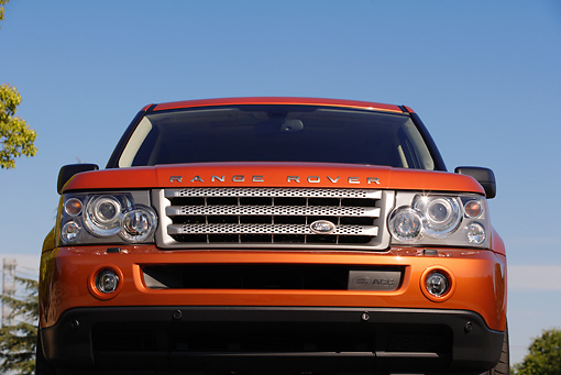 AUT 15 RK0906 01 © Kimball Stock 2006 Land Rover Range Rover Supercharged Orange Head On Shot
