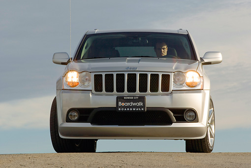 AUT 15 RK0937 01 © Kimball Stock 2006 Jeep Grande Cherokee SRT8 Silver Low Head On View On Pavement