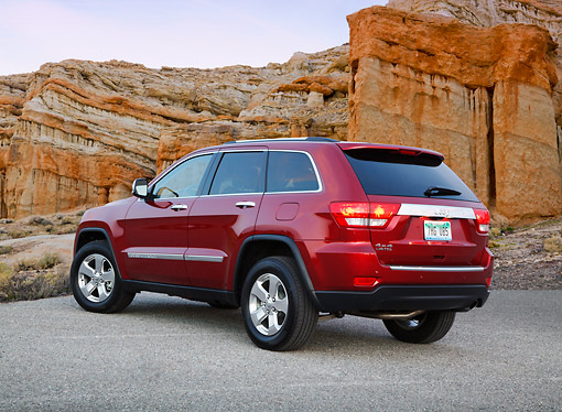 AUT 15 RK1249 01 © Kimball Stock 2012 Jeep Grand Cherokee Limited 4X4 Red 3/4 Rear View On Pavement