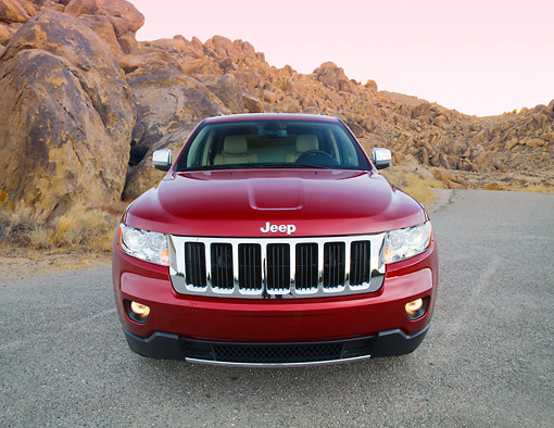 AUT 15 RK1251 01 © Kimball Stock 2012 Jeep Grand Cherokee Limited 4X4 Red Front View On Pavement