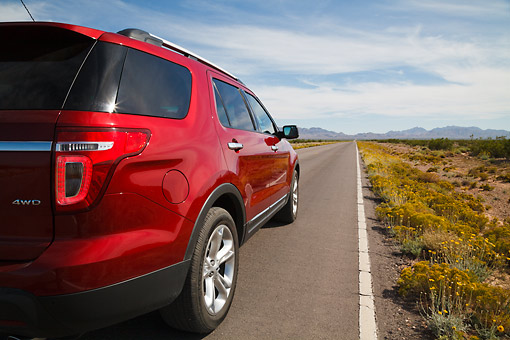 AUT 15 RK1259 01 © Kimball Stock 2013 Ford Explorer Red 3/4 Rear View On Road In Desert