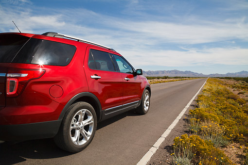AUT 15 RK1260 01 © Kimball Stock 2013 Ford Explorer Red 3/4 Rear View On Road In Desert