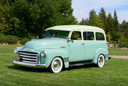 AUT 15 RK1348 01 © Kimball Stock 1951 GMC Suburban Two-Tone Green 3/4 Front View On Grass By Trees