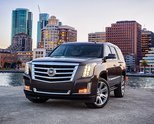AUT 15 RK1351 01 © Kimball Stock 2015 Cadillac Escalade Black 3/4 Front View By City Towers