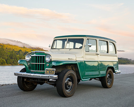 AUT 15 RK1358 01 © Kimball Stock 1960 Willys-Overland Jeep Station Wagon 4x4 Green And White 3/4 Front View By River