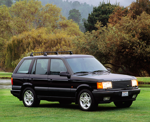AUT 15 RK0023 02 © Kimball Stock 1996 Land Rover Range Rover Turbo Black 3/4 Front View On Grass Trees Background