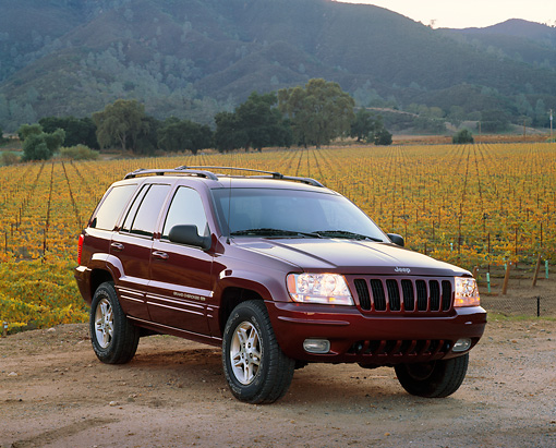 AUT 15 RK0119 03 © Kimball Stock 1999 Jeep Grand Cherokee Limited Burgundy 3/4 Front View On Dirt