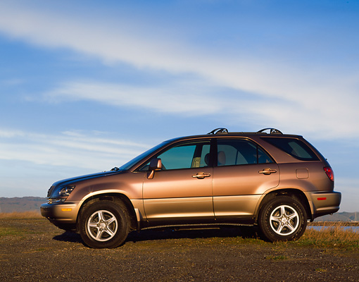 AUT 15 RK0135 04 © Kimball Stock 1999 Lexus RX300 Side View On Dirt Blue Sky
