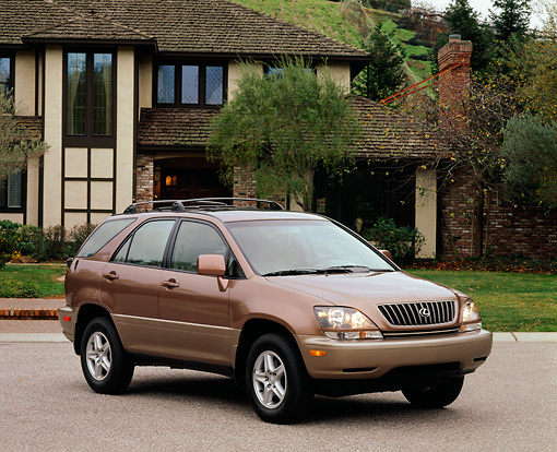 AUT 15 RK0154 04 © Kimball Stock 1999 Lexus RX300 Bronze 3/4 Front View On Pavement By House