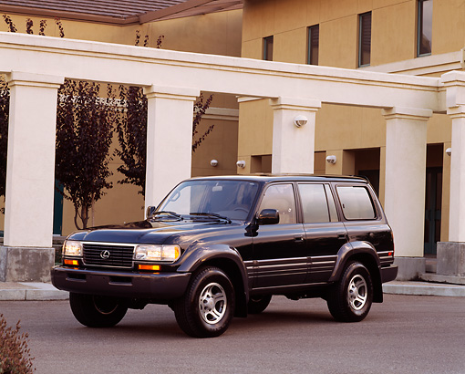 AUT 15 RK0222 02 © Kimball Stock 1997 Lexus LX450 Black 3/4 Front View On Pavement By Building