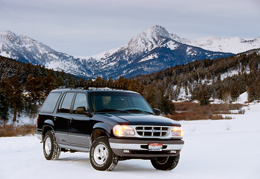 AUT 15 RK0270 04 © Kimball Stock 1996 Ford Explorer Black Front 3/4 View On Snow By Mountains