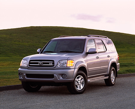 AUT 15 RK0470 02 © Kimball Stock 2001 Toyota Sequoia Gray 3/4 Front View On Pavement By Grass Hills At Dusk