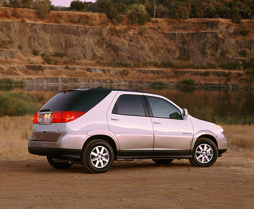 AUT 15 RK0544 05 © Kimball Stock 2002 Buick Rendezvous AWD White 3/4 Rear View On Dirt By Quarry
