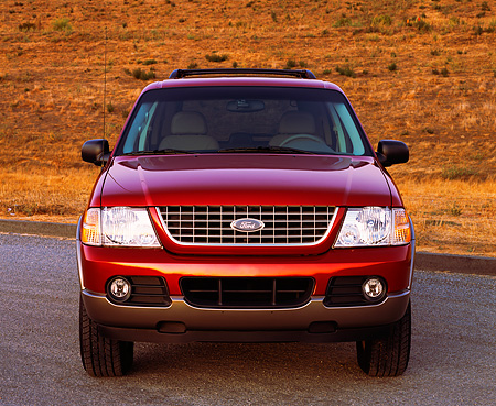AUT 15 RK0547 10 © Kimball Stock 2002 Ford Explorer Burgundy Head On Shot On Pavement Dry Grass Hill