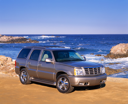 AUT 15 RK0598 10 © Kimball Stock 2002 Cadillac Escalade Canepa Design LE Pewter 3/4 Front View On Sand By Ocean
