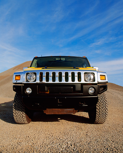 AUT 15 RK0625 09 © Kimball Stock 2003 Gm H2 Hummer Yellow Wide Angle Low Head On Shot On Gravel Blue Sky