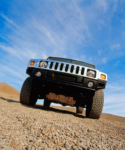 AUT 15 RK0625 11 © Kimball Stock 2003 Gm H2 Hummer Yellow Wide Angle Low Head On Shot On Gravel Blue Sky