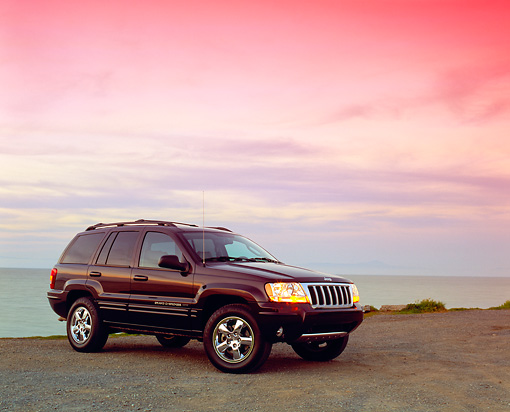 AUT 15 RK0774 03 © Kimball Stock 2004 Jeep Cherokee Limited Burgundy 3/4 Side View On Sand By Water Filtered