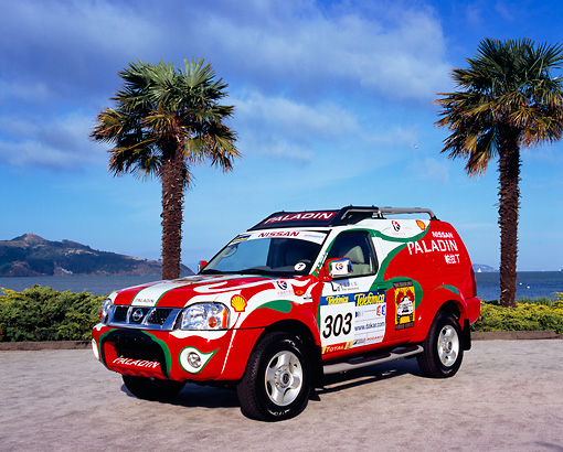 AUT 15 RK0795 01 © Kimball Stock Nissan Paladin Race Car 3/4 Front View On Pavement By Palm Trees