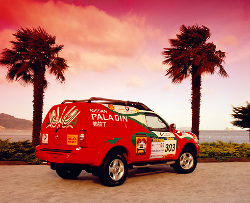 AUT 15 RK0798 05 © Kimball Stock Nissan Paladin Rally Car 3/4 Rear View On Pavement By Palm Trees