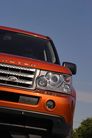 AUT 15 RK0907 01 © Kimball Stock 2006 Land Rover Range Rover Supercharged Orange Partial Head On Shot