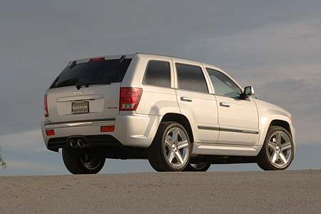 AUT 15 RK0936 01 © Kimball Stock 2006 Jeep Grand Cherokee SRT8 Silver Low 3/4 Rear View On Pavement