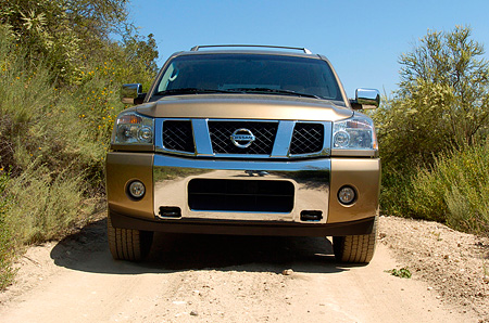 AUT 15 RK0949 01 © Kimball Stock 2004 Nissan Armada Gold Low Head On Shot On Dirt