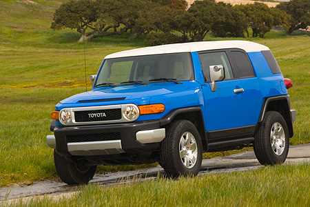 AUT 15 RK0965 01 © Kimball Stock 2007 Toyota FJ Cruiser Blue And White 3/4 Front View On Pavement By Grass Hills