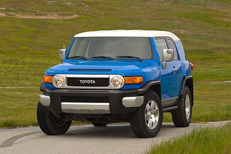 AUT 15 RK0966 01 © Kimball Stock 2007 Toyota FJ Cruiser Blue And White 3/4 Front View On Pavement By Grass Hills