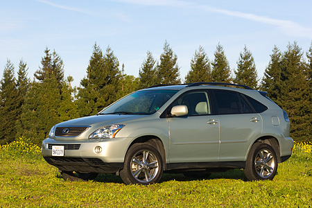 AUT 15 RK0984 01 © Kimball Stock 2006 Lexus RX400 Hybrid Light Green 3/4 Side View By Trees