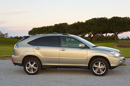 AUT 15 RK0986 01 © Kimball Stock 2006 Lexus RX400 Hybrid Light Green Profile View On Pavement By Trees At Dusk