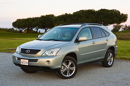 AUT 15 RK0987 01 © Kimball Stock 2006 Lexus RX400 Hybrid Light Green 3/4 Front View On Pavement By Trees At Dusk