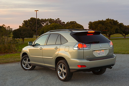 AUT 15 RK0988 01 © Kimball Stock 2006 Lexus RX400 Hybrid Light Green 3/4 Rear View On Pavement By Trees At Dusk