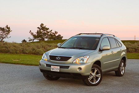 AUT 15 RK0989 01 © Kimball Stock 2006 Lexus RX400 Hybrid Light Green 3/4 Front View On Pavement By Grass Hills At Dusk