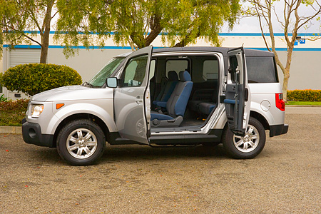 AUT 15 RK0991 01 © Kimball Stock 2006 Honda Element Silver Profile View Doors Open On Pavement By Trees