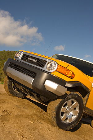 AUT 15 RK1018 01 © Kimball Stock 2007 Toyota FJ Cruiser Yellow And White Low 3/4 Front View On Dirt Hill