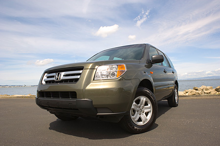 AUT 15 RK1033 01 © Kimball Stock 2006 Honda Pilot LX Green Low 3/4 Front View On Pavement By Water