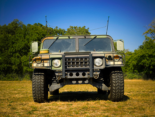 AUT 15 RK1058 01 © Kimball Stock 1982 Hummer M998 National Guard Low Head On View On Grass