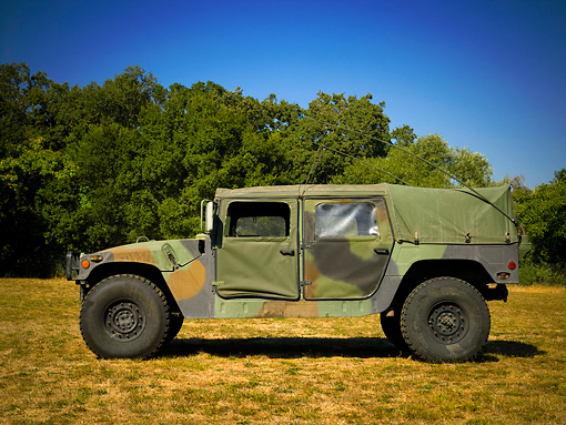 AUT 15 RK1059 01 © Kimball Stock 1982 Hummer M998 National Guard Low Profile View On Grass