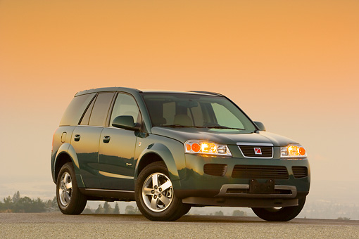 AUT 15 RK1080 01 © Kimball Stock 2007 Saturn Vue Hybrid Green 3/4 Front View On Pavement