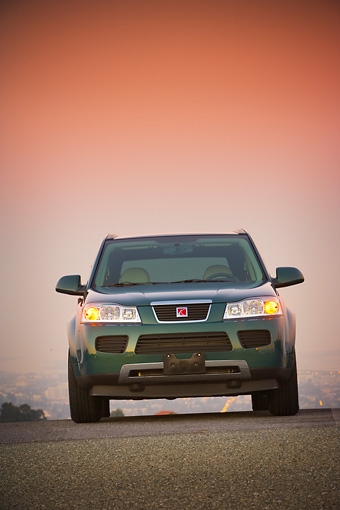 AUT 15 RK1082 01 © Kimball Stock 2007 Saturn Vue Hybrid Green Low Head On View On Pavement