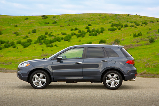 AUT 15 RK1085 01 © Kimball Stock 2007 Acura RDX Tech Turbo Gray Profile View On Pavement