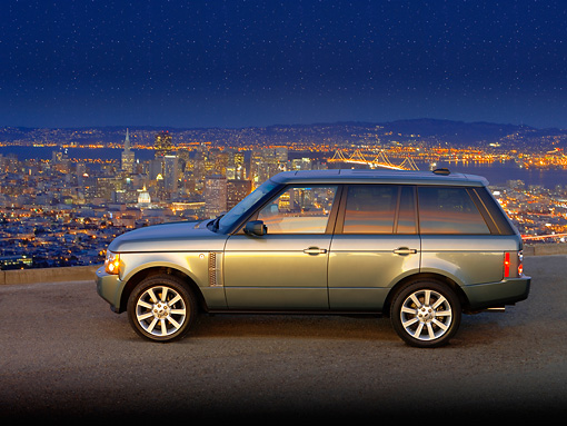 AUT 15 RK1096 01 © Kimball Stock 2007 Land Rover Range Rover Supercharged Green Profile View On Pavement City Background