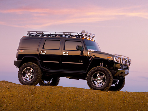 AUT 15 RK1107 01 © Kimball Stock 2007 Hummer H2 Black Low 3/4 Front View On Dirt Hill